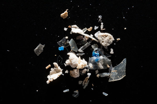Fragments of microplastic on a black background