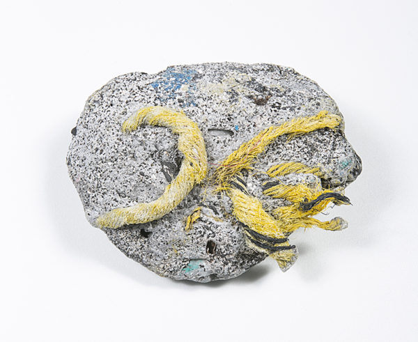 Plastiglomerate sample collected by Patricia Corcoran (geographer) and Kelly Jazvac (artist/sculptor) at Kamilo Beach, Hawaii, 2013. Photography by: Kelly Wood.