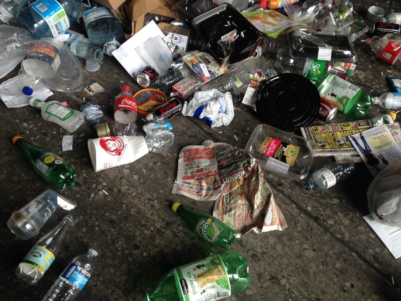 Waste items on the sorting room floor of a waste recovery facility. Photo: Max Liboiron