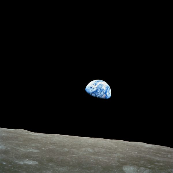 "The earth rising in a photo taken from the moon called ""Spaceship Earth"" by Bill Anders on Apollo 8 in lunar orbit"