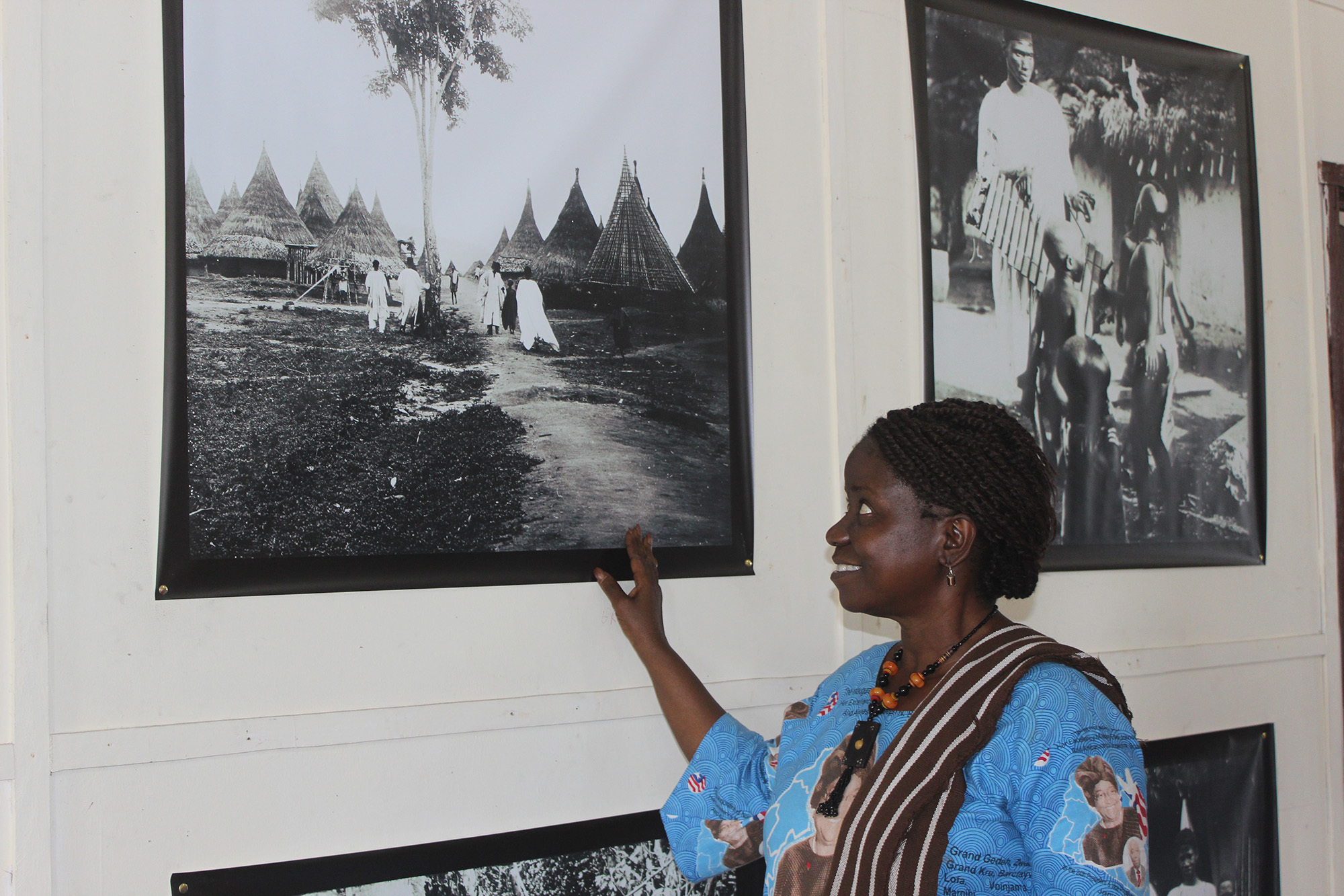 Ms. Louise McMillan Siaway, assistant Minister of Culture, with her favorite Paul Julien on display in the exhibition at the National Museum of Liberia. The exhibition was curated by Andrea Stultiens and opened by Ms. McMillan Siaway, 2014