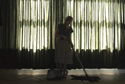 Els Hollanders practicing singing with vacuum cleaner, still from documented performance