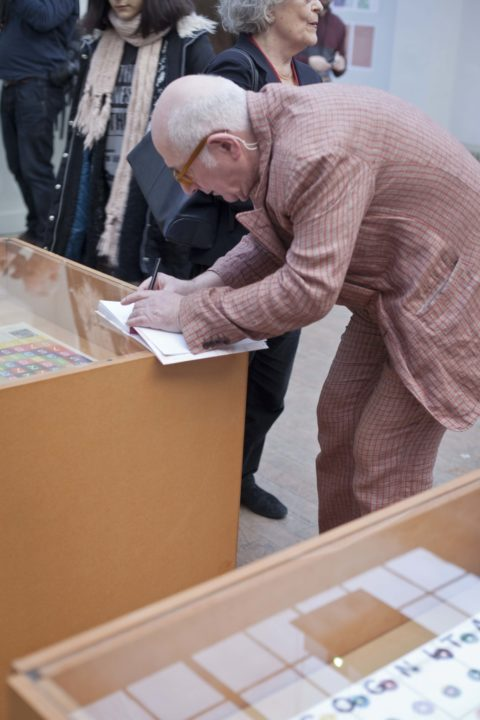 Karel Martens signing his publication during the opening of the exhibition at the KABK
