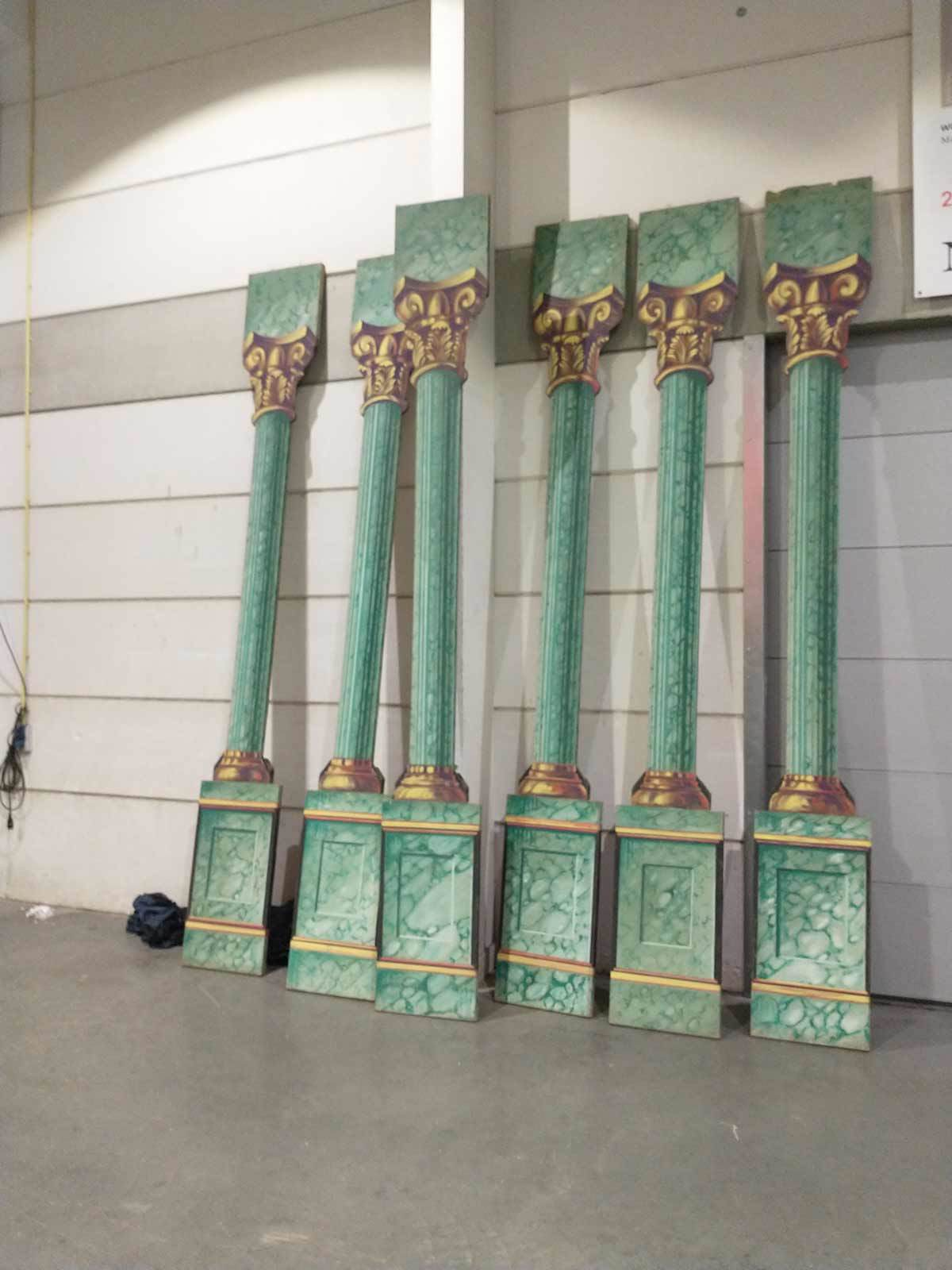 A set of painted columns from the Van den Berghe collection of historical stage scenery