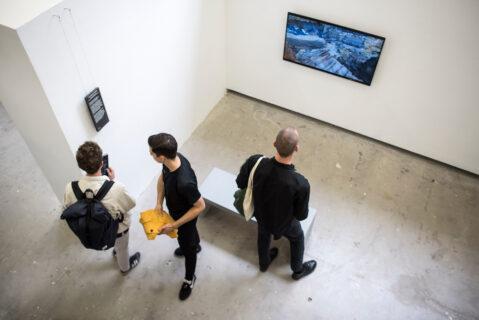visitors at Jean-Baptiste Caste's installation during the opening of KABK presentation of My Practice, My Politics at Stroom Den Haag